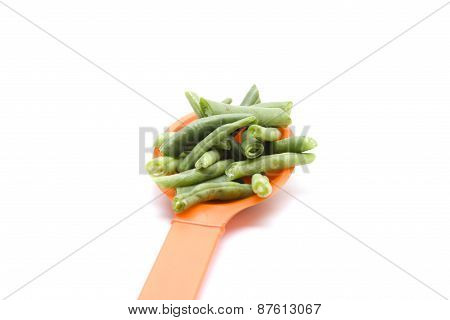 Fresh Green Beans on Plastic Spoon