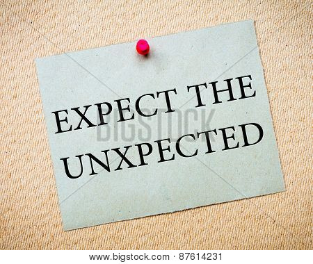 Expect the Unexpected Message. Recycled paper note pinned on cork board. Concept Image poster