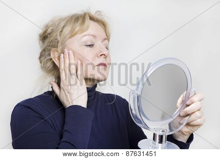 Older Woman Looking In Mirror