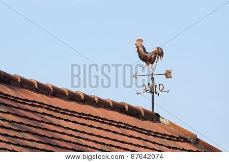 Copper Weathercock On The Rooftop