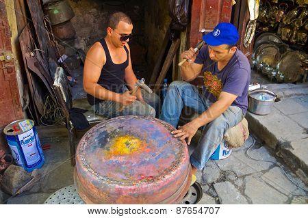 Young Moroccan Men Forging A Copper Pot