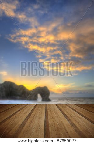 Colourful Winter Sunrises Behind Durdle Door On Jurassic Coast In England With Wooden Planks Floor