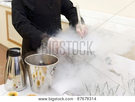 Chef is cooking ice cream with liquid nitrogen, catering event