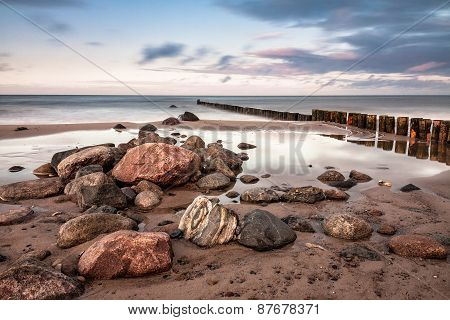 Groynes on shore of the Baltic Sea. poster