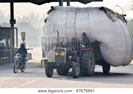 Jaipur, India - December 30, 2014: Indian Man Driving Heavily Overloaded Truck In Jaipur.
