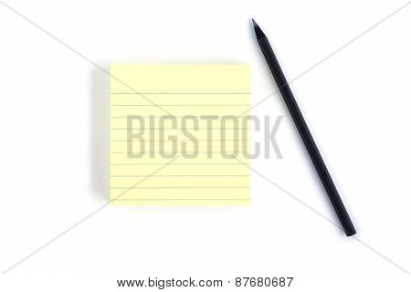 Blank yellow note pad with black pencil