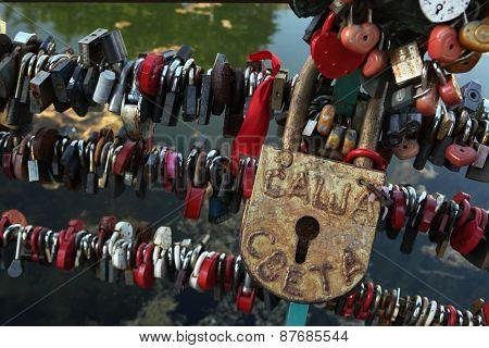 DMIRTOV, RUSSIA - JULY 8, 2012: Love locks fixed in the Dmitrov Kremlin in Dmitrov near Moscow, Russia.