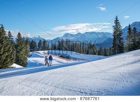 Mountain skiing slopes skiing at Hausberg top near Garmisch-Partenkirchen town in Bavarian Alpes