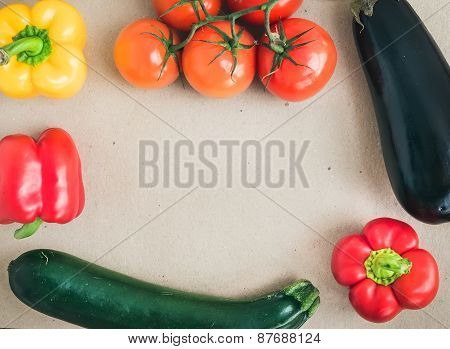 Vegetable Set: Ripe Tomatoes, Paprika, Zuccini And An Aggplant On A Craft Paper Background With A Co