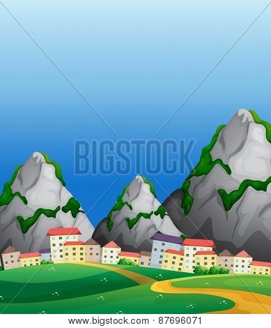 View of countryside with buildings and mountains