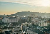 The view over the Pest side Gellert hill and the big wheel in Budapest Hungary from Saint Istvan's Basilica view tower on a winter day poster
