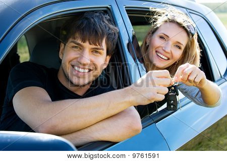 Happy Couple In New Car