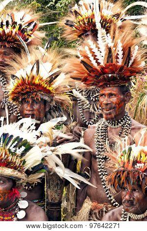 Papuan Korafe tribe warriors wearing traditional bird of paradise feather headdress and body decora