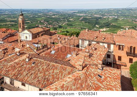 View on red roofs and green hills on background in Piedmont, Northern Italy.
