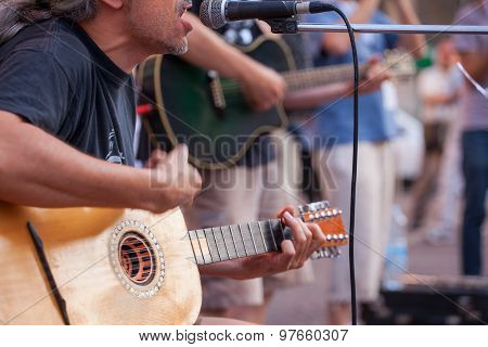 Guitar Player During The Street Concert