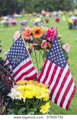 two flags on graveside