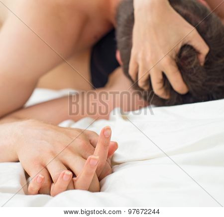 Passionate Couple Making Love In Bed.