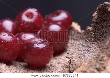 Sour Cherry Against A Wooden Background