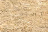 Chipboard wood background and alternative construction material - Texture on wooden panel in construction yard - Retro seamless backdrop pattern - Pressed particleboard for house isolation coating poster