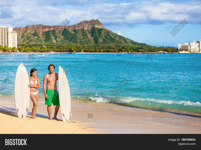 Hawaii Surf Couple On Waikiki Beach In Honolulu Summer Holidays Travel Destination Young
