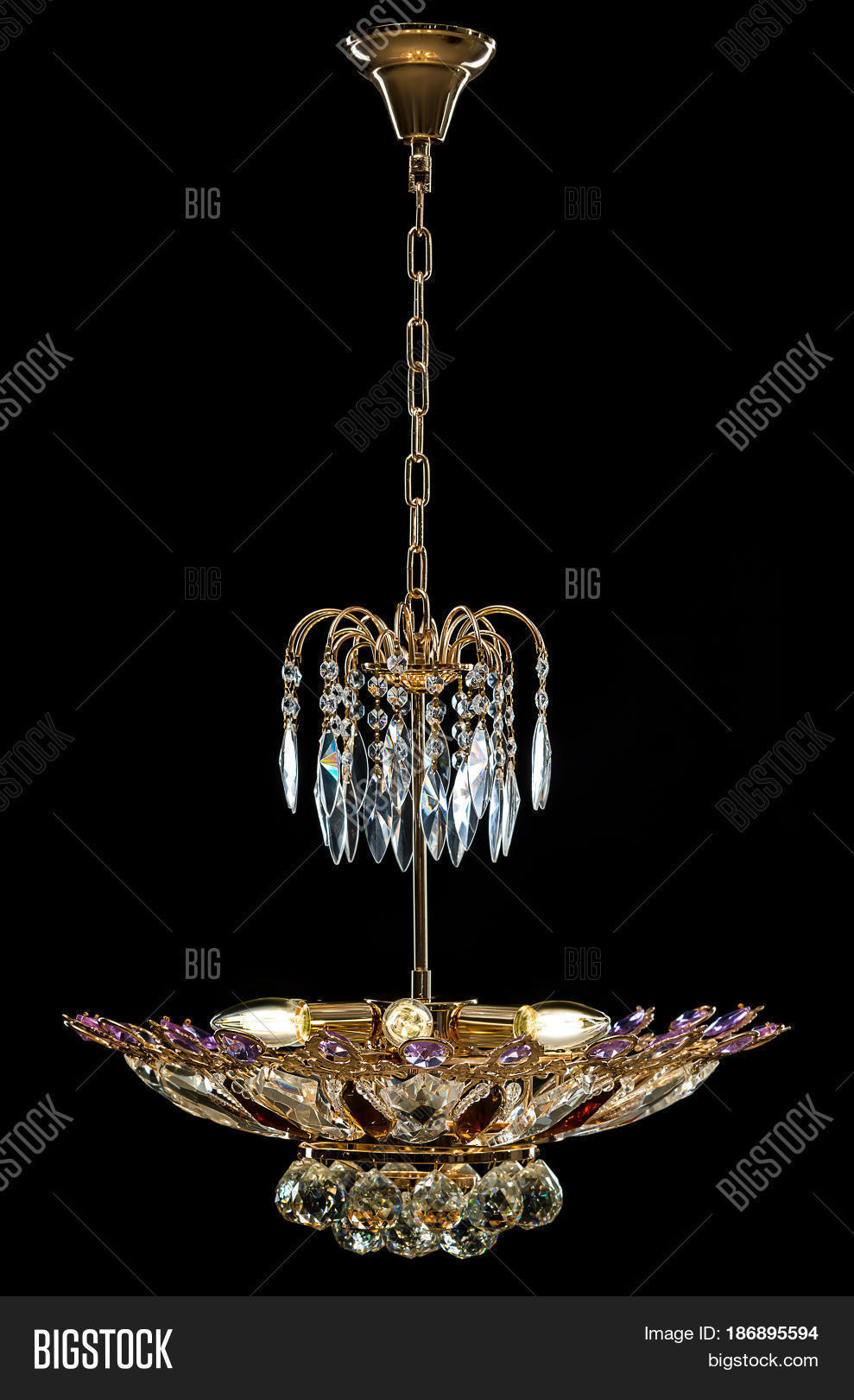 Contemporary Gold Chandelier Isolated On Black Background Crystal Decorated Purple Crystals