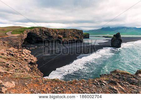 Amazing summer day on Black beach, Reynisdrangar, Vik, Iceland, Europe.