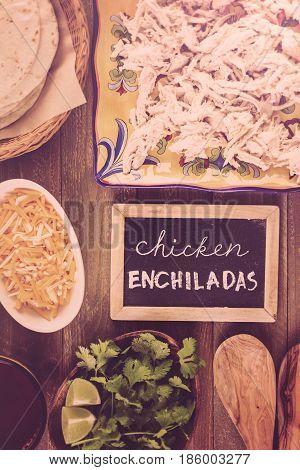 Ingredients for preparing homemade chicken enchiladas .