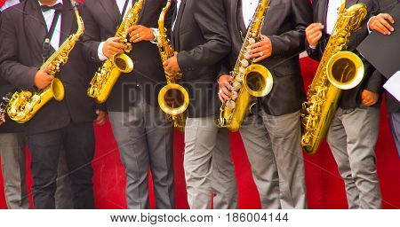 Quito, Ecuador - December 09, 2016: An unidentified people Big Band saxophone section, view of a row of saxophone players in mid performance.