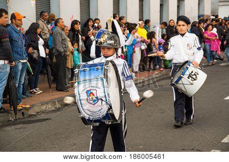 Quito, Ecuador - December 09, 2016: An unidentified boys playing a drum in parade in Quito, Ecuador.