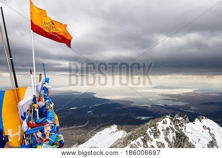 MUNKU-SARDYK RUSSIAN-MONGOLIAN BORDER - April 29 2017: Hubsugul lake and vertex tour Munku-Sardyk. View from peak to south. Overcast. Gusty wind