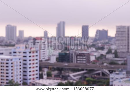 Abstract blurred city landscape background with lens flare light:blurry backdrop wallpaper concept in bankok thailand.
