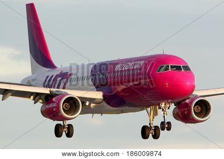 PRAGUE, CZECH REPUBLIC - NOVEMBER 2, 2012: Wizz Air Airbus A320 HA-LWK landing at Ruzyne international airport.