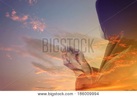 muslim woman praying with sky in Twilight time , Double Exposure Effect