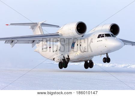 BARNEO ICE CAMP, NORTH POLE - APRIL 17, 2013: Antonov An-74 RA-74020 takes off at Barneo ice camp.