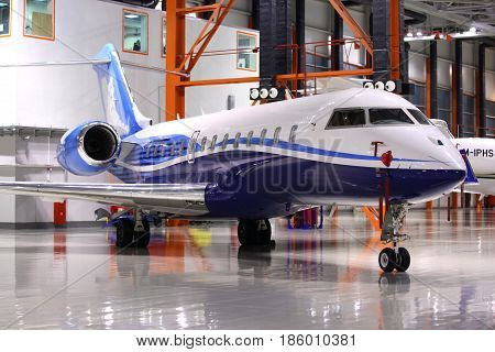 SHEREMETYEVO, MOSCOW REGION, RUSSIA - DECEMBER 22, 2011: Private Bombardier Global 5000 OY-SGC standing in a hangar at Sheremetyevo international airport.