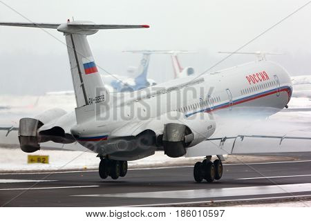 VNUKOVO, MOSCOW REGION, RUSSIA - FEBRUARY 11, 2013: Ilyushin IL-62M RA-86559 of Russian Air Force landing at Vnukovo international airport.