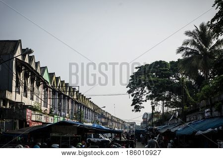 store in serius with cloud and plam tree photo takein indonesia bogor java