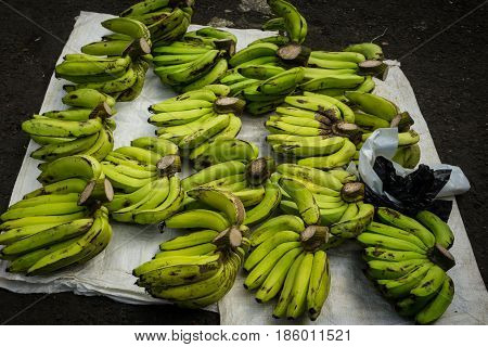 Plantains on top of tarpaulin on sale at traditional market photo taken in Bogor Indonesia java