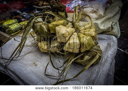 Rice wraped with coconut leaf with diamond shape on sale in traditional market Bogor Indonesia java