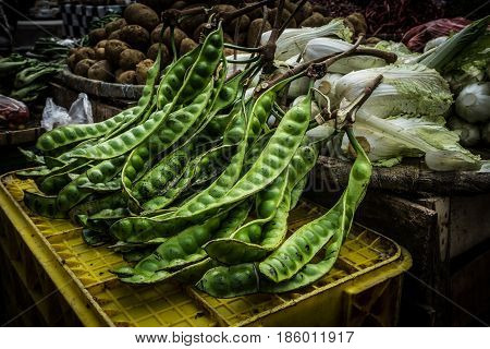 Petai or bitter bean is one of local food has smelly flavour and aroma sells in traditional market photo taken in Bogor Indonesia java