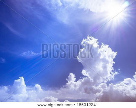 sun light with blue sky and white clous with grain