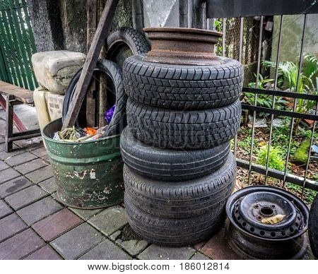 Stacked tire near a dust bin on side the street photo taken in Jakarta Indonesia java