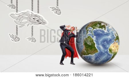 A scared businessman in a red cape cowering under an attack of paper comets with a globe behind him. International business. Protecting the clients. Unexpected adversary.
