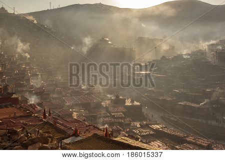 Top view monastery at Larung gar (Buddhist Academy) in a warm and foggy morning time Sichuan China