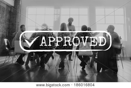 Business team in the meeting room with approved word