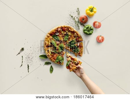 Hand taking a slice of italian cuisine pizza