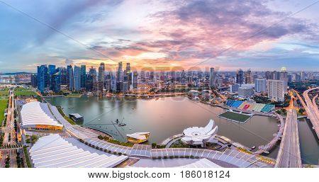 Panorama top view of Singapore City skyline at sunset.