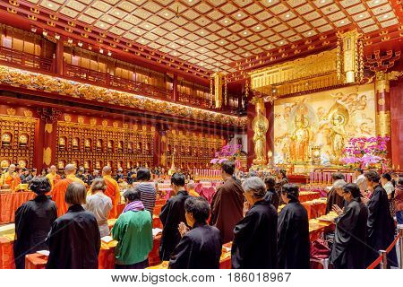 Prayer In The Buddha Tooth Relic Temple At Singapore