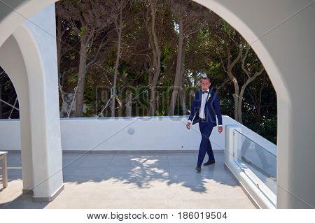 Outdoor shot of young handsome bridegroom