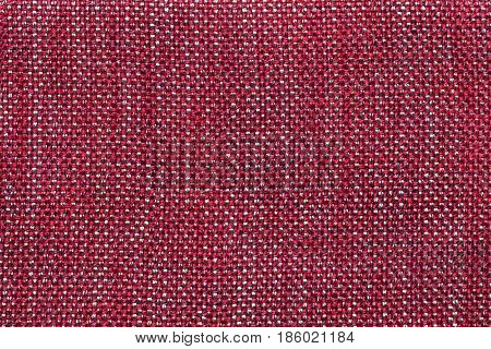 Dark red background with checkered pattern closeup. Structure of the wine fabric with natural texture. Cloth backdrop.